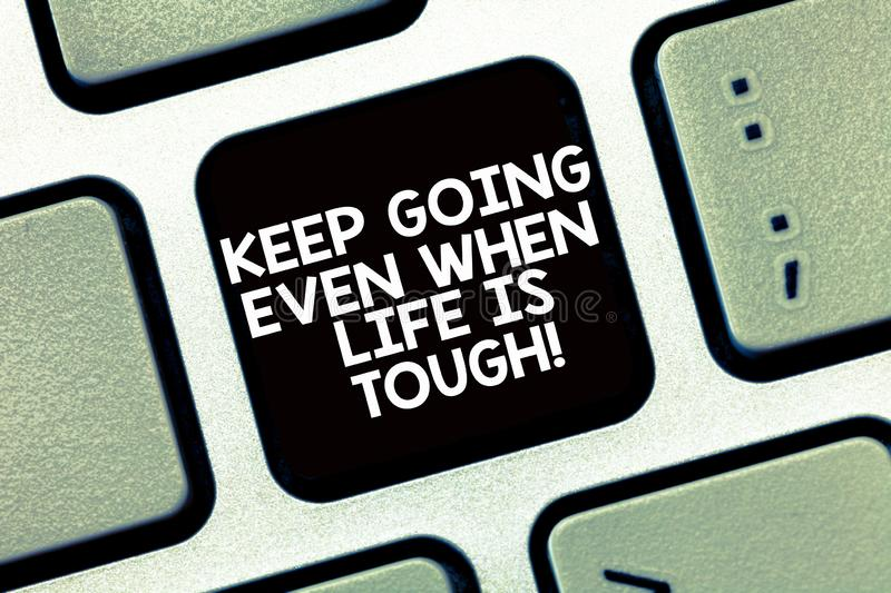 Conceptual hand writing showing Keep Going Even When Life Is Tough. Business photo text Overcome difficulties reach your. Goals Keyboard Intention to create stock images