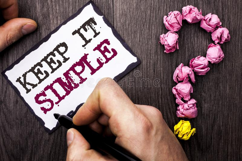 Conceptual hand writing showing Keep It Simple. Business photo text Simplify Things Easy Understandable Clear Concise Ideas writte. N by Man Sticky Note Holding stock image