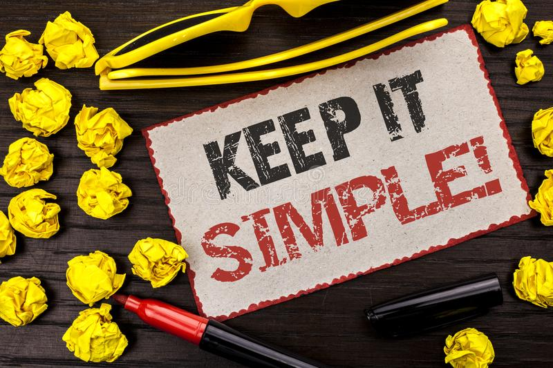 Conceptual hand writing showing Keep It Simple Motivational Call. Business photo text Simplify Things Easy Clear Concise Ideas wri. Tten Cardboard Piece the stock images