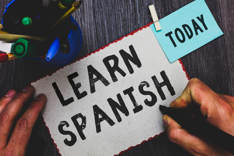 Conceptual hand writing showing Learn Spanish. Business photo text Translation Language in Spain Vocabulary Dialect Speech Man hol. Ding marker paper clothespin royalty free stock images