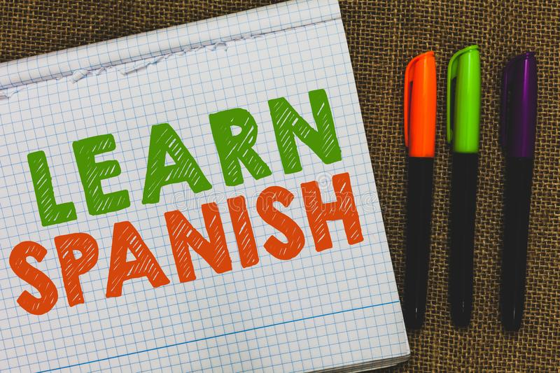 Conceptual hand writing showing Learn Spanish. Business photo text Translation Language in Spain Vocabulary Dialect Speech Open no. Tebook jute background royalty free stock image