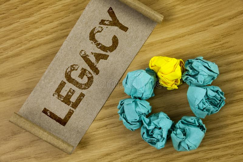 Conceptual hand writing showing Legacy. Business photo showcasing Transmitted Received from an ancestor Money Properties given by. Will written Cardboard Paper stock photography