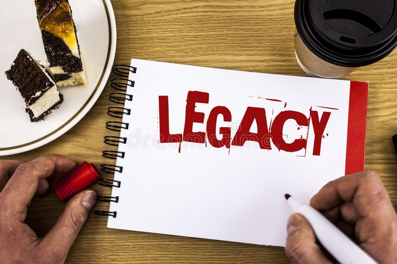 Conceptual hand writing showing Legacy. Business photo showcasing Transmitted Received from an ancestor Money Properties given by. Will written by Man Notebook royalty free stock image