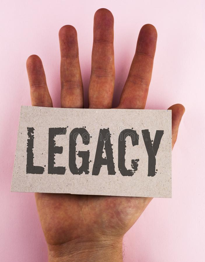 Conceptual hand writing showing Legacy. Business photo text Transmitted Received from an ancestor Money Properties given by will w. Ritten Cardboard Piece placed royalty free stock photo