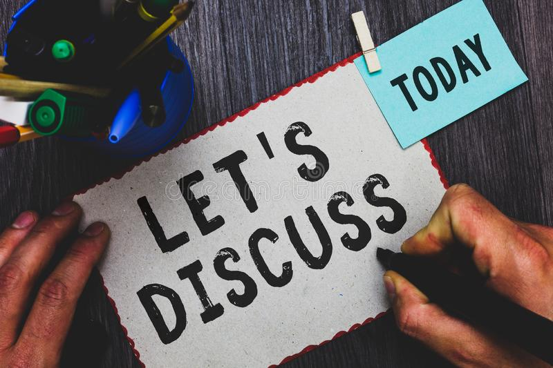 Conceptual hand writing showing Let s is Discuss. Business photo text Permit to Talk Open Up Go Over a Topic Chat Sharing Man hold. Ing marker paper clothespin royalty free stock photos