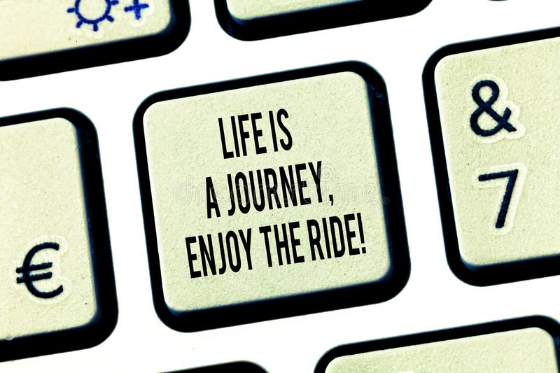 Conceptual hand writing showing Life Is A Journey Enjoy The Ride. Business photo text Enjoying things that happen. Everyday Keyboard key Intention to create royalty free stock images