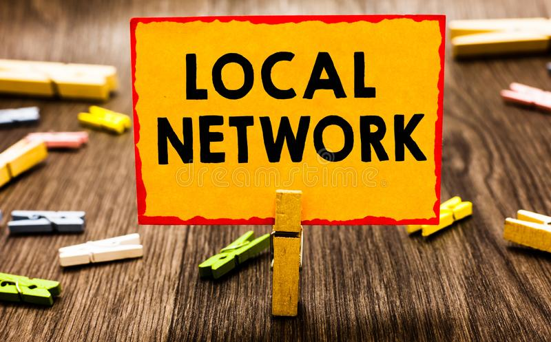 Conceptual hand writing showing Local Network. Business photo showcasing Intranet LAN Radio Waves DSL Boradband Switch. Connection Clothespin holding orange stock images