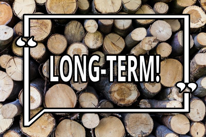 Conceptual hand writing showing Long Term. Business photo showcasing Occurring over large period of time Future plans Wooden. Background vintage wood wild stock image