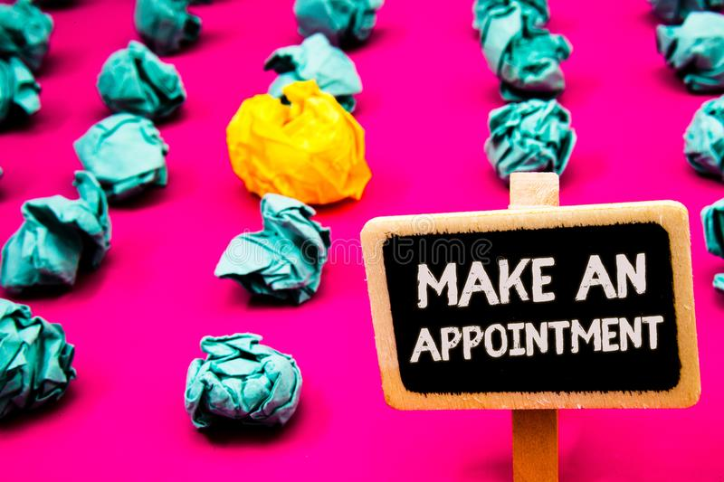 Conceptual hand writing showing Make An Appointment. Business photo text Schedule Arrangement Deadline Session Engagement Blackboa. Rd with white letter pink royalty free stock images