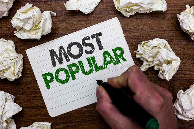 Conceptual hand writing showing Most Popular. Business photo showcasing Liked Followed Enjoyed by majority of the people in a soci. Ety Man holding marker stock photography