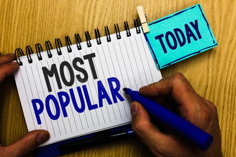 Conceptual hand writing showing Most Popular. Business photo showcasing Liked Followed Enjoyed by majority of the people in a soci. Ety Man holding marker stock photo