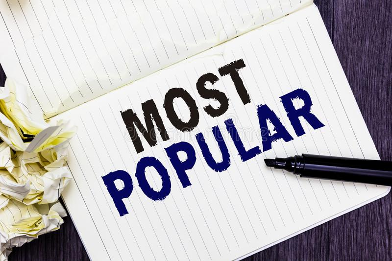 Conceptual hand writing showing Most Popular. Business photo text Liked Followed Enjoyed by majority of the people in a society Ma. Rker over notebook crumpled stock images