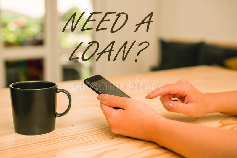 Conceptual hand writing showing Need A Loan Question. Business photo showcasing asking he need money expected paid back. Conceptual hand writing showing Need A royalty free stock image