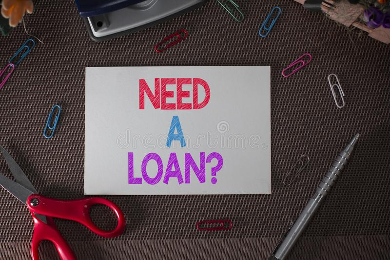 Conceptual hand writing showing Need A Loan Question. Business photo text asking he need money expected paid back with. Conceptual hand writing showing Need A royalty free stock image