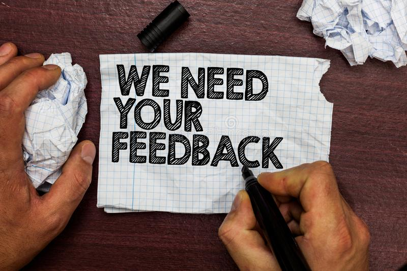 Conceptual hand writing showing We Need Your Feedback. Business photo text Give us your review thoughts comments what to improve H. And hold pen sketch word on stock photo