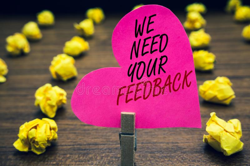 Conceptual hand writing showing We Need Your Feedback. Business photo text Give us your review thoughts comments what to improve P. Aperclip hold pink written royalty free stock image