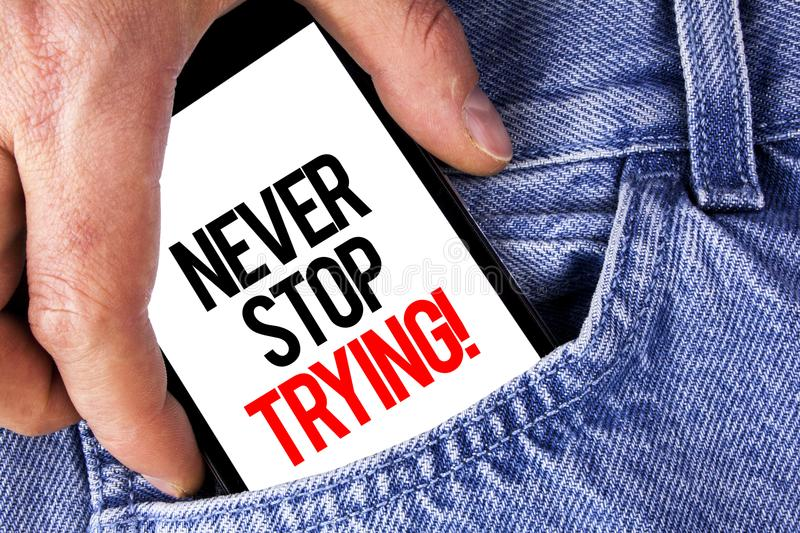 Conceptual hand writing showing Never Stop Trying Motivational Call. Business photo showcasing go on do not give up Self confidenc. E written Mobile phone stock photography
