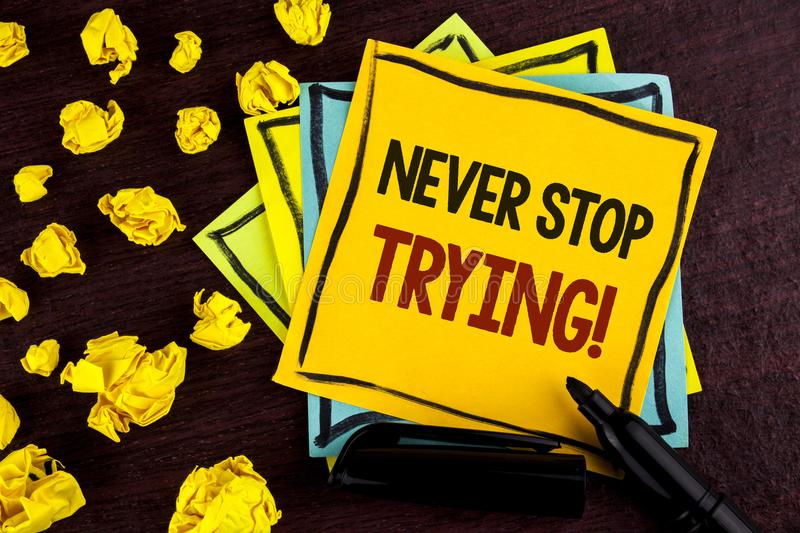 Conceptual hand writing showing Never Stop Trying Motivational Call. Business photo showcasing go on do not give up Self confidenc. E written Sticky Note Paper royalty free stock images