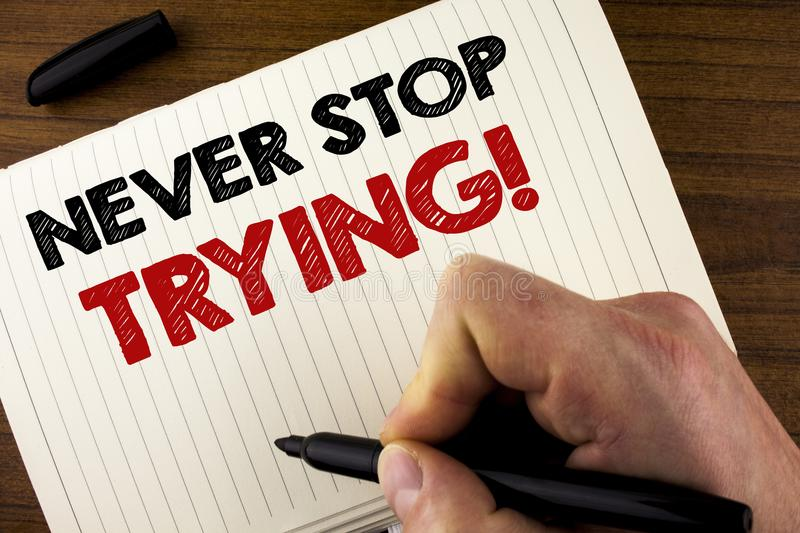Conceptual hand writing showing Never Stop Trying Motivational Call. Business photo showcasing go on do not give up Self confidenc. E written by Man Notebook royalty free stock photo