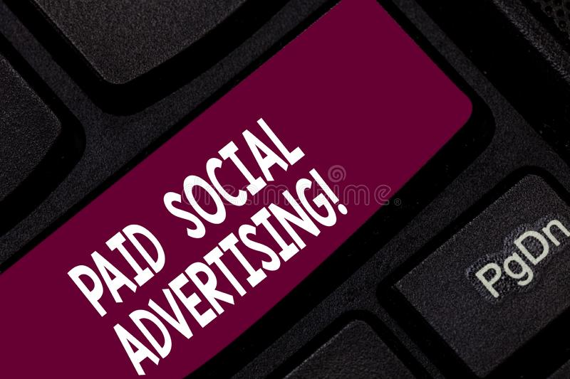 Conceptual hand writing showing Paid Social Advertising. Business photo showcasing external marketing efforts involve a. Paid placement Keyboard key Intention royalty free stock images