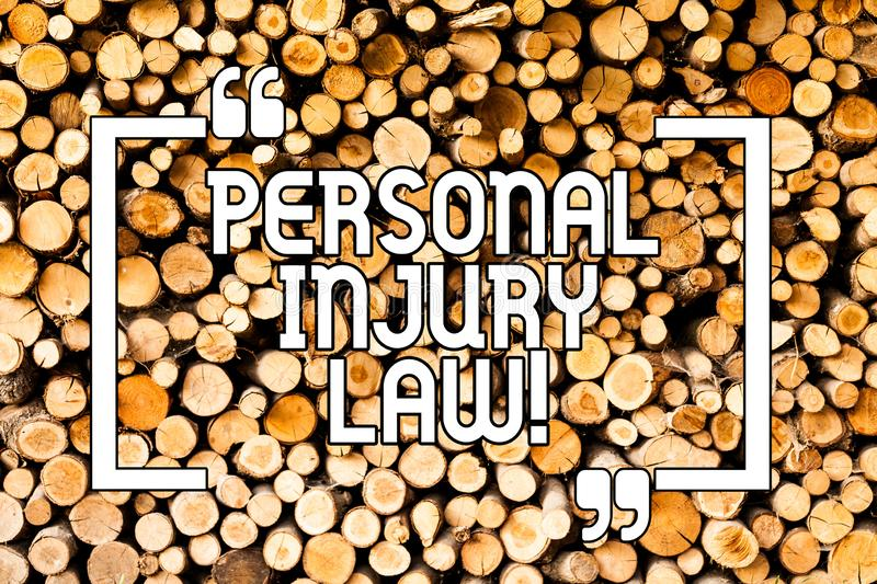 Conceptual hand writing showing Personal Injury Law. Business photo showcasing guarantee your rights in case of hazards or risks. Wooden background vintage wood stock photography