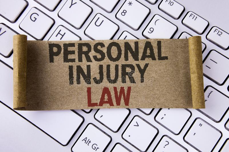 Conceptual hand writing showing Personal Injury Law. Business photo showcasing guarantee your rights in case of hazards or risks w. Ritten Folded Cardboard Paper royalty free stock image