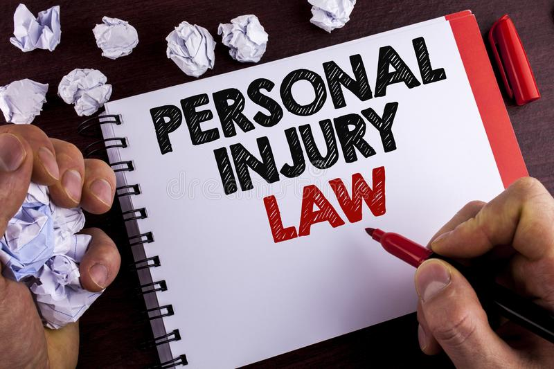 Conceptual hand writing showing Personal Injury Law. Business photo text guarantee your rights in case of hazards or risks written. By Man Notepad wooden stock photos