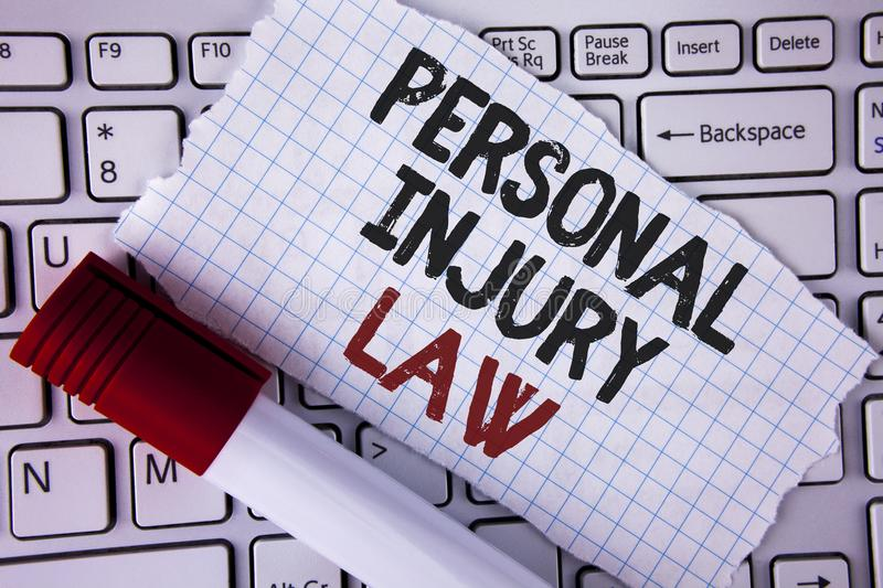 Conceptual hand writing showing Personal Injury Law. Business photo text guarantee your rights in case of hazards or risks written. Tear Notebook paper placed royalty free stock images