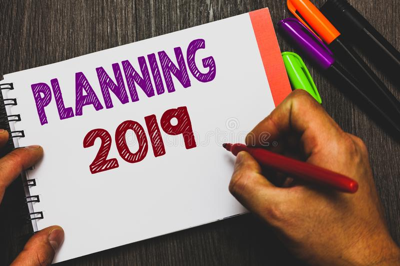 Conceptual hand writing showing Planning 2019. Business photo text Begin with end in the Mind Positioning Long term Objectives Man. Holding notebook paper stock images