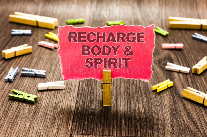 Conceptual hand writing showing Recharge BodyandSpirit. Business photo text fill your energy through relaxation and having fun Cli stock image