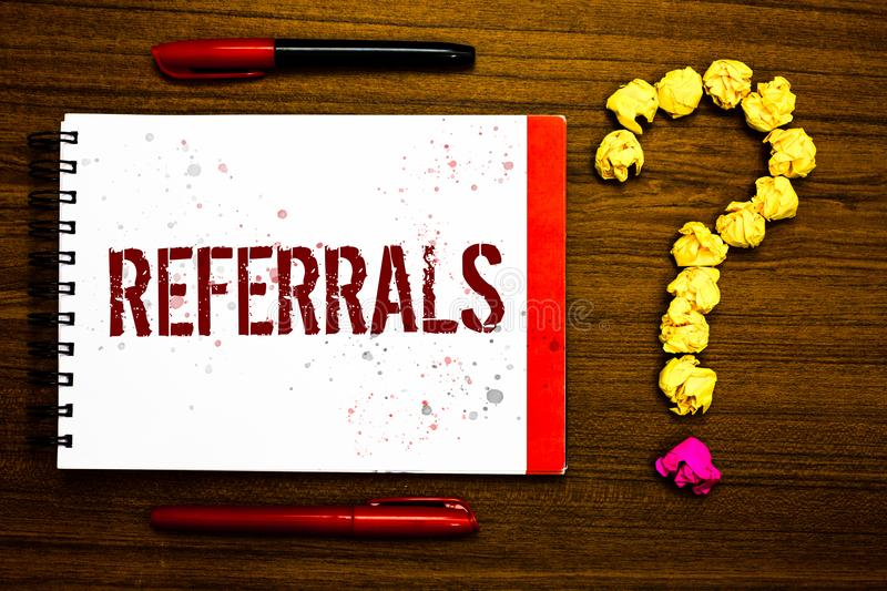 Conceptual hand writing showing Referrals. Business photo text Act of referring someone or something for consultation review Marke. R notepad nice art ask royalty free stock images