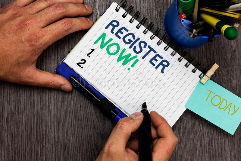 Conceptual hand writing showing Register Now. Business photo showcasing Name in an Official List Enlist to be a Member Sign up Man. Holding marker notebook stock photography