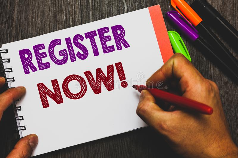 Conceptual hand writing showing Register Now. Business photo text Name in an Official List Enlist to be a Member Sign up Man holdi. Ng notebook paper royalty free stock photography