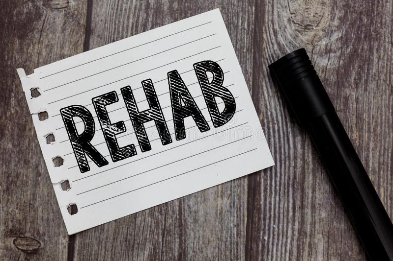 Conceptual hand writing showing Rehab. Business photo text course treatment for drug alcohol dependence typically at. Residential stock photo