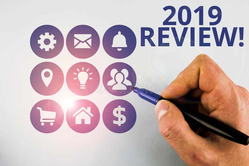 Conceptual hand writing showing 2019 Review. Business photo text remembering past year events main actions or good shows. Conceptual hand writing showing 2019 royalty free stock images