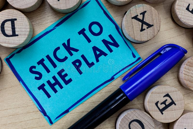 Conceptual hand writing showing Stick To The Plan. Business photo text To adhere to some plan and not deviate from it Follow royalty free stock images