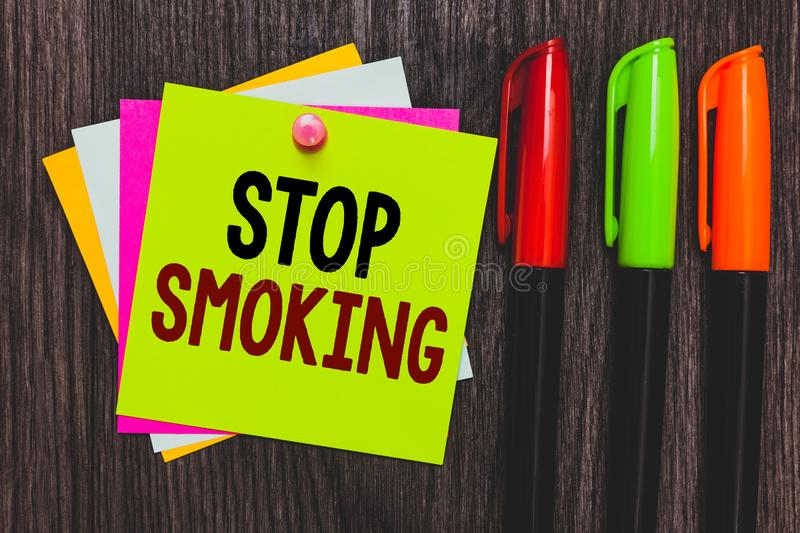 Conceptual hand writing showing Stop Smoking. Business photo showcasing Discontinuing or stopping the use of tobacco addiction Pap royalty free stock images