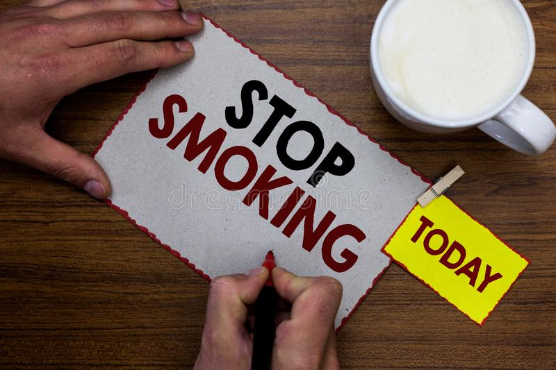Conceptual hand writing showing Stop Smoking. Business photo text Discontinuing or stopping the use of tobacco addiction Man holdi royalty free stock photo