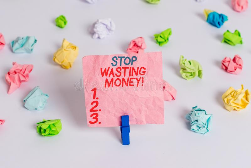 Conceptual hand writing showing Stop Wasting Money. Business photo text advicing demonstrating or group to start saving. Conceptual hand writing showing Stop royalty free stock photo