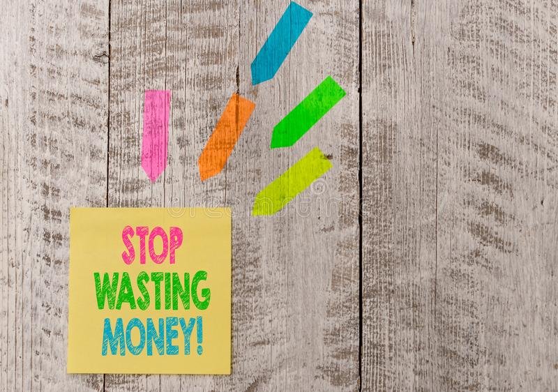 Conceptual hand writing showing Stop Wasting Money. Business photo text advicing demonstrating or group to start saving. Conceptual hand writing showing Stop stock photo