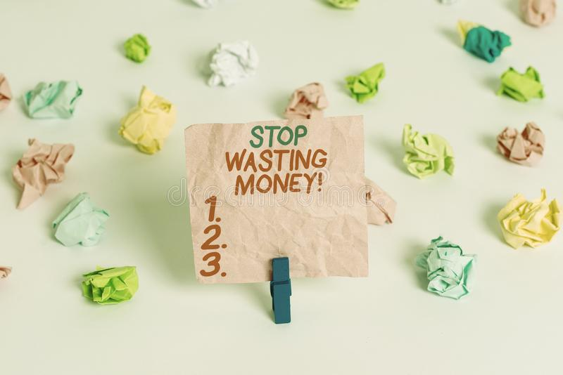 Conceptual hand writing showing Stop Wasting Money. Business photo text advicing demonstrating or group to start saving. Conceptual hand writing showing Stop stock photography