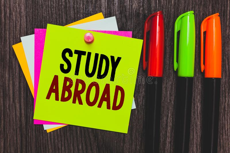 Conceptual hand writing showing Study Abroad. Business photo showcasing Pursuing educational opportunities in a foreign country Pa stock photography