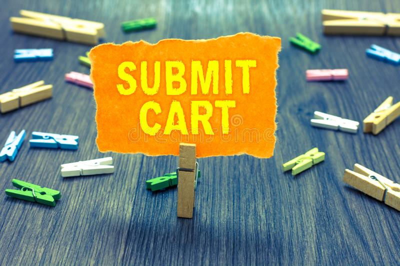 Conceptual hand writing showing Submit Cart. Business photo text Sending shopping list of online items Proceed checkout Clothespin. Holding orange paper note royalty free stock photos