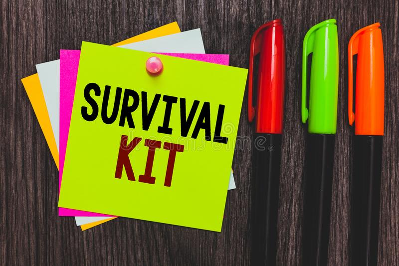 Conceptual hand writing showing Survival Kit. Business photo showcasing Emergency Equipment Collection of items to help someone Pa. Per notes Communicate ideas stock photography