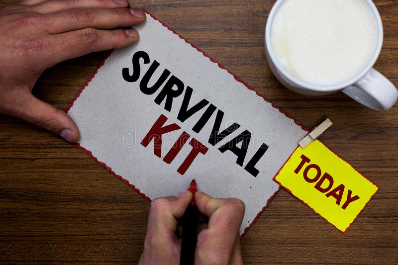 Conceptual hand writing showing Survival Kit. Business photo text Emergency Equipment Collection of items to help someone Man hold. Ing marker notebook reminder stock photography