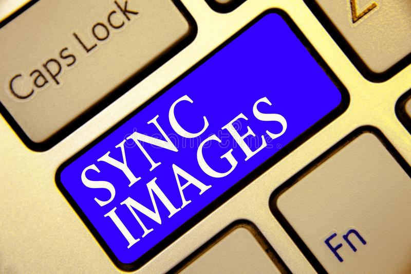 Conceptual hand writing showing Sync Images. Business photo showcasing Making photos identical in all devices Accessible anywhere. Keyboard blue key Intention stock images