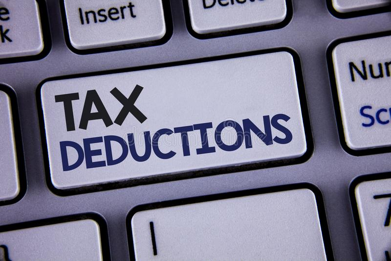 Conceptual hand writing showing Tax Deductions. Business photo showcasing Reduction on taxes Investment Savings Money Returns Text. Two words backspace button royalty free stock photo