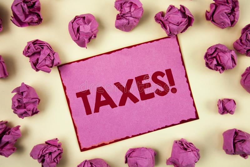 Conceptual hand writing showing Taxes Motivational Call. Business photo showcasing Money demanded by a government for its support. Written Sticky Note Paper stock images