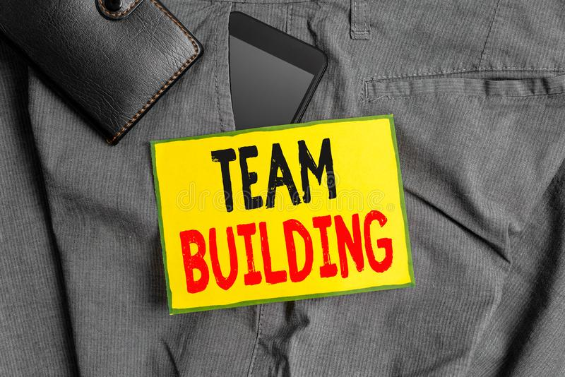 Conceptual hand writing showing Team Building. Business photo showcasing various types of activities used to enhance. Conceptual hand writing showing Team royalty free stock images