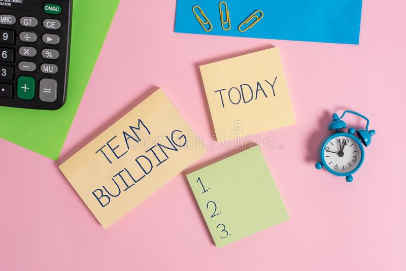 Conceptual hand writing showing Team Building. Business photo showcasing various types of activities used to enhance. Conceptual hand writing showing Team royalty free stock photo
